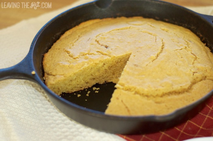 Skillet Honey Cornbread in skillet sliced